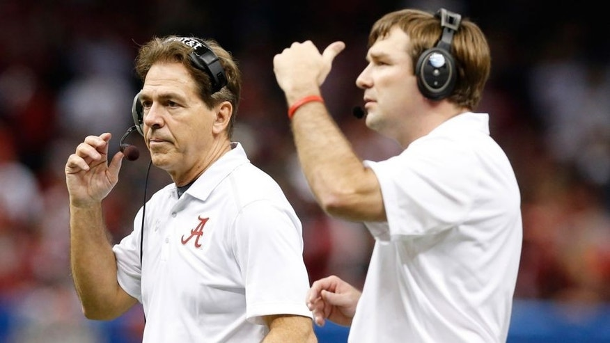 Jan 1, 2015; New Orleans, LA, USA; Alabama Crimson Tide head coach Nick Saban and defensive coordinator Kirby Smart (right) on the sidelines against the Ohio State Buckeyes in the 2015 Sugar Bowl at Mercedes-Benz Superdome. Mandatory Credit: Matthew Emmons-USA TODAY Sports