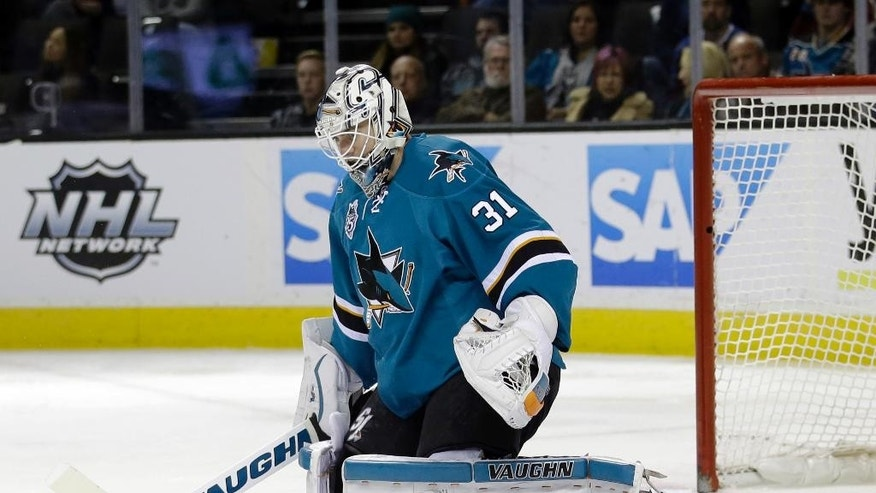 San Jose Sharks goalie Martin Jones stops a shot by the Colorado Avalanche during the second period of an NHL hockey game Monday, Dec. 28, 2015, in San Jose, Calif. (AP Photo/Marcio Jose Sanchez)