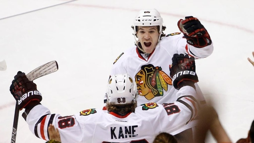 Chicago Blackhawks' Patrick Kane (88) celebrates his goal against the Arizona Coyotes with Andrew Shaw (65) during the second period of an NHL hockey game Tuesday, Dec. 29, 2015, in Glendale, Ariz. (AP Photo/Ross D. Franklin)