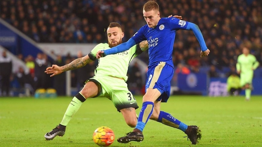 LEICESTER, ENGLAND - DECEMBER 29: Jamie Vardy of Leicester City is challenged by Nicolas Otamendi of Manchester City as he shoots during the Barclays Premier League match between Leicester City and Manchester City at The King Power Stadium on December 29, 2015 in Leicester, England. (Photo by Michael Regan/Getty Images)