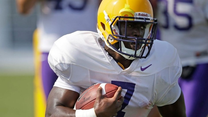 <p>FILE - In this Aug. 6, 2014, file photo, LSU freshman running back Leonard Fournette (7) runs through drills during an NCAA college football practice in Baton Rouge, La. Fournette headlines another promising group looking to make an immediate impact. (AP Photo/Gerald Herbert, File)</p>