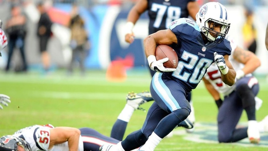 Dec 27, 2015; Nashville, TN, USA; Tennessee Titans running back Bishop Sankey (20) runs for a first down during the second half against the Houston Texans at Nissan Stadium. The Texans won 34-6. Mandatory Credit: Christopher Hanewinckel-USA TODAY Sports