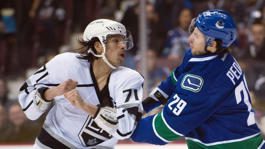Vancouver Canucks defenseman Andrey Pedan (29) fights with Los Angeles Kings center Jordan Nolan (71) during the first period of an NHL hockey game Monday, Dec. 28, 2015, in Vancouver, British Columbia. (Jonathan Hayward/The Canadian Press via AP)