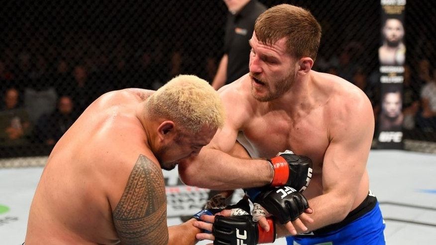 ADELAIDE, AUSTRALIA - MAY 10: (R-L) Stipe Miocic elbows Mark Hunt in their heavyweight bout during the UFC Fight Night event at the Adelaide Entertainment Centre on May 10, 2015 in Adelaide, Australia. (Photo by Josh Hedges/Zuffa LLC/Zuffa LLC via Getty Images)