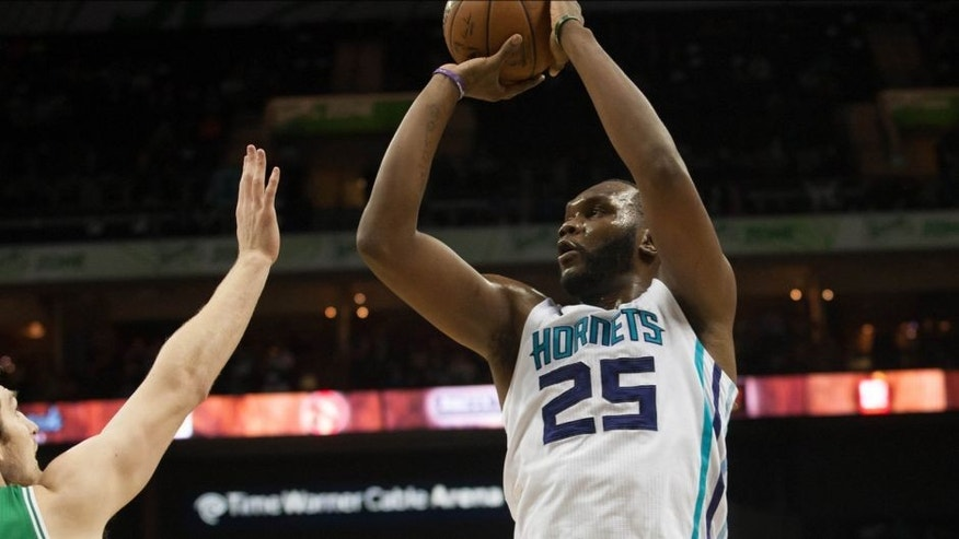 Mar 30, 2015; Charlotte, NC, USA; Charlotte Hornets center Al Jefferson (25) shoots the ball over Boston Celtics center Tyler Zeller (44) during the first half at Time Warner Cable Arena. Mandatory Credit: Jeremy Brevard-USA TODAY Sports
