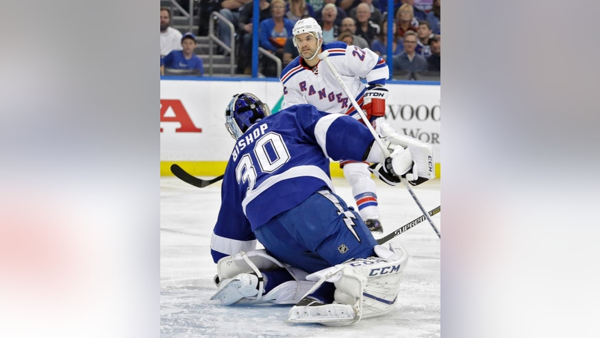 New York Rangers defenseman Dan Boyle (22) watches his shot get past Tampa Bay Lightning goalie Ben Bishop (30) for a goal during the first period of an NHL hockey game Wednesday, Dec. 30, 2015, in Tampa, Fla. (AP Photo/Chris O'Meara)
