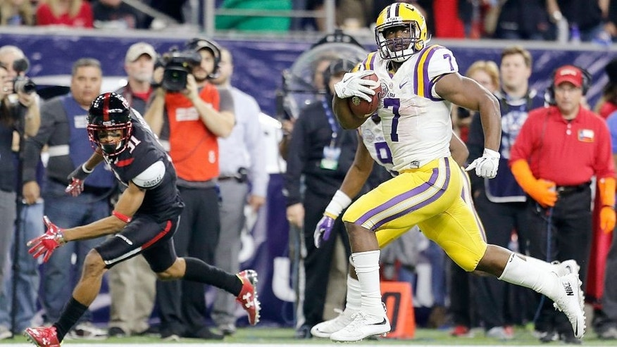 Dec 29, 2015; Houston, TX, USA; LSU Tigers running back Leonard Fournette (7) catches the ball and runs for a touchdown against the Texas Tech Red Raiders in the second quarter at NRG Stadium. Mandatory Credit: Thomas B. Shea-USA TODAY Sports