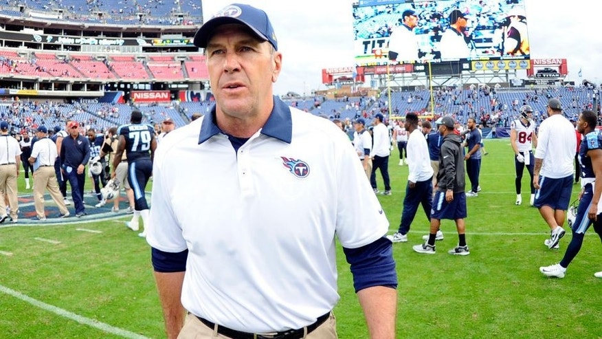 Dec 27, 2015; Nashville, TN, USA; Tennessee Titans interim head coach Mike Mularkey leaves the field after a loss against the Houston Texans at Nissan Stadium. The Texans won 34-6. Mandatory Credit: Christopher Hanewinckel-USA TODAY Sports