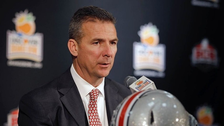 <p>Ohio State head coach Urban Meyer answers a question during a news conference in Fort Lauderdale, Fla., Thursday, Jan. 2, 2014. Ohio State will face Clemson in the NCAA college football Orange Bowl classic, Friday, Jan. 3, in Miami Gardens, Fla. <br> </p>