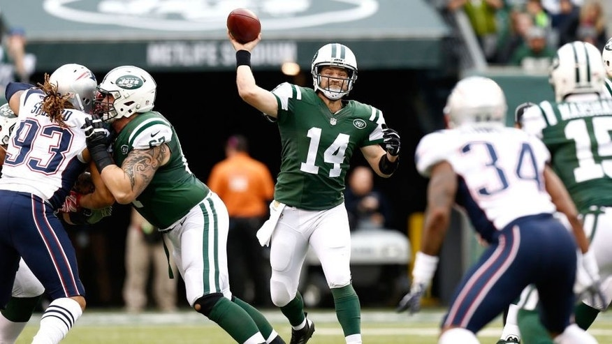 EAST RUTHERFORD, NJ - DECEMBER 27: Ryan Fitzpatrick #14 of the New York Jets throws a pass in the first quarter against the New England Patriots during their game at MetLife Stadium on December 27, 2015 in East Rutherford, New Jersey. (Photo by Jeff Zelevansky/Getty Images)