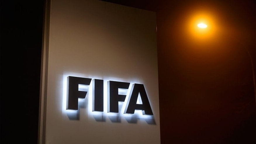 "A sign of the FIFA is seen at the entrance of its headquarters on December 3, 2015 in Zurich. The multi-million dollar corruption scandal engulfing FIFA widened on December 3, with 16 people indicted by US justice officials who pledged an unremitting crackdown on an ""outrageous"" betrayal of trust. / AFP / FABRICE COFFRINI (Photo credit should read FABRICE COFFRINI/AFP/Getty Images)"
