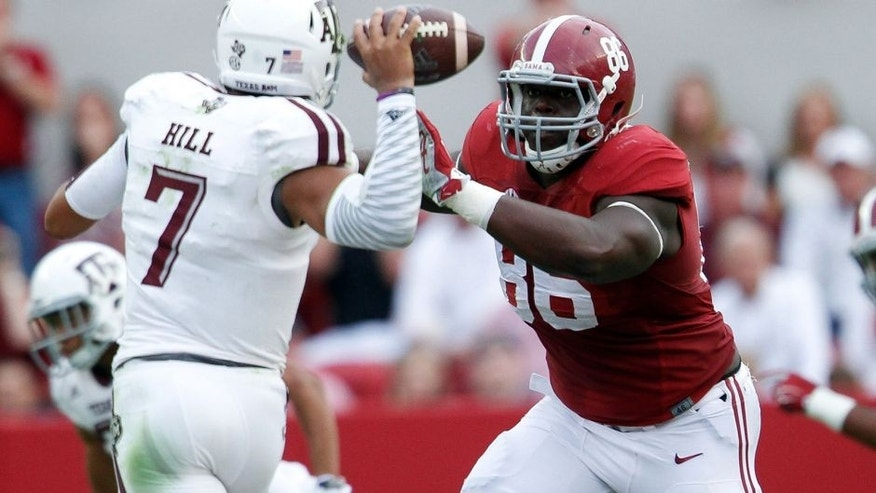 Oct 18, 2014; Tuscaloosa, AL, USA; Alabama Crimson Tide defensive lineman A'Shawn Robinson (86) puts the pressure on Texas A&M Aggies quarterback Kenny Hill (7) at Bryant-Denny Stadium. The Crimson Tide defeated the Aggies 59-0. Mandatory Credit: Marvin Gentry-USA TODAY Sports