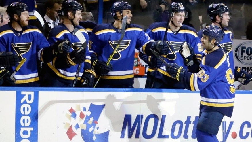 St. Louis Blues' Scott Gomez (93) celebrates with teammates after scoring in the first period of an NHL hockey game against the Tampa Bay Lightning, Tuesday, Oct. 27, 2015 in St. Louis. (AP Photo/Tom Gannam)