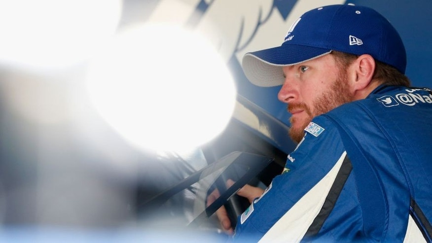 HOMESTEAD, FL - NOVEMBER 20: Dale Earnhardt Jr., driver of the #88 Nationwide Chevrolet, stands in the garage area during practice for the NASCAR Sprint Cup Series Ford EcoBoost 400 at Homestead-Miami Speedway on November 20, 2015 in Homestead, Florida. (Photo by Brian Lawdermilk/Getty Images)