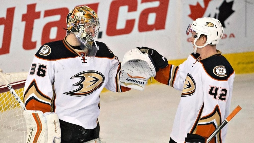 Anaheim Ducks goalie John Gibson (36) and teammate Josh Manson (42) celebrate the team's 1-0 win over the Edmonton Oilers during an NHL hockey game Thursday, Dec. 31, 2015, in Edmonton, Alberta. (Jason Franson/The Canadian Press via AP)