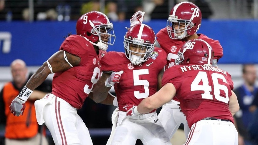 Dec 31, 2015; Arlington, TX, USA; Alabama Crimson Tide defensive back Cyrus Jones (5) celebrates with teammates after returning a punt for a touchdown against the Michigan State Spartans in the third quarter in the 2015 CFP semifinal at the Cotton Bowl at AT&T Stadium. Mandatory Credit: Matthew Emmons-USA TODAY Sports
