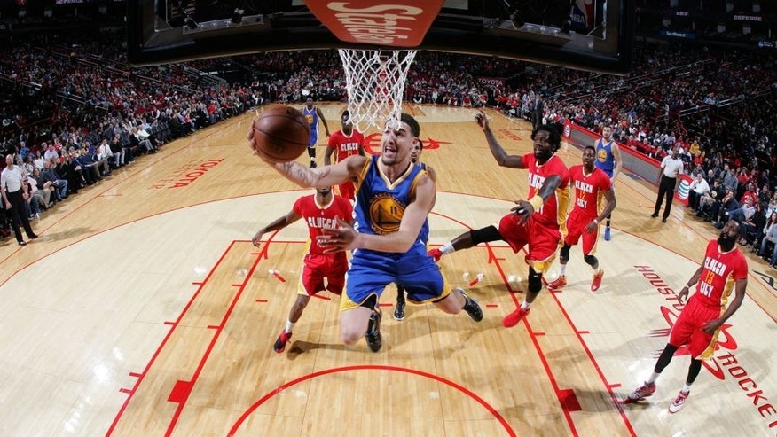 HOUSTON, TX - DECEMBER 31: Klay Thompson #11 of the Golden State Warriors goes to the basket against the Houston Rockets on December 31, 2015 at the Toyota Center in Houston, Texas. NOTE TO USER: User expressly acknowledges and agrees that, by downloading and or using this photograph, User is consenting to the terms and conditions of the Getty Images License Agreement. Mandatory Copyright Notice: Copyright 2015 NBAE (Photo by Bill Baptist/NBAE via Getty Images)