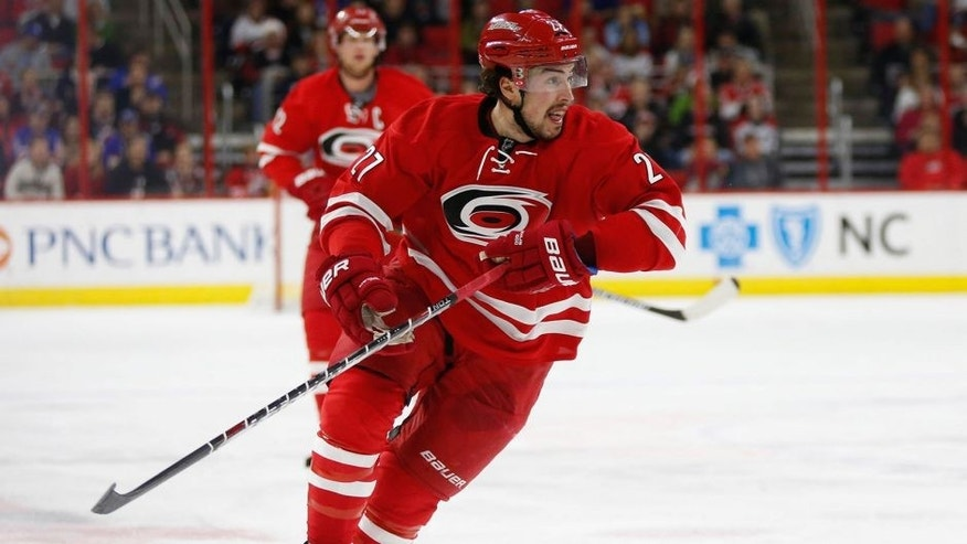 Dec 20, 2014; Raleigh, NC, USA; Carolina Hurricanes defensemen Justin Faulk (27) skates against the New York Rangers at PNC Arena. The New York Rangers defeated the Carolina Hurricanes 3-2 in the shoot out. Mandatory Credit: James Guillory-USA TODAY Sports