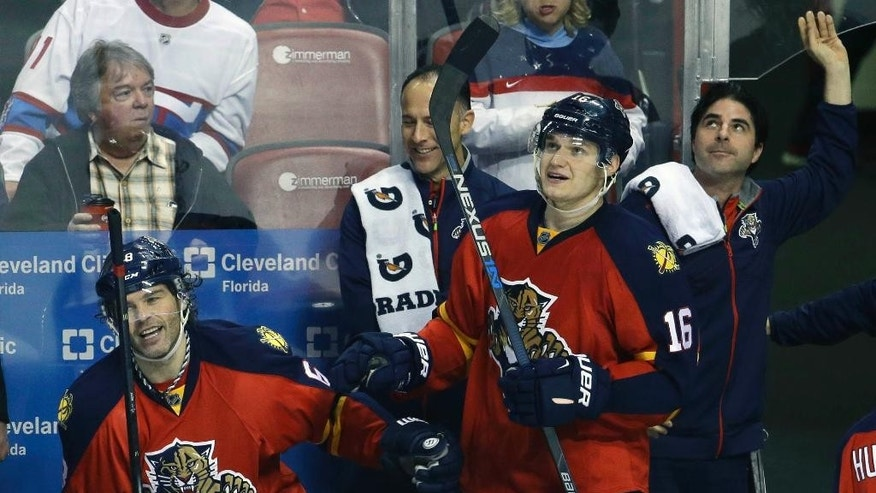 Florida Panthers right wing Jaromir Jagr, left, is congratulated by center Aleksander Barkov (16) after scoring a goal during the second period of an NHL hockey game against the Montreal Canadiens, Tuesday, Dec. 29, 2015, in Sunrise, Fla. (AP Photo/Lynne Sladky)