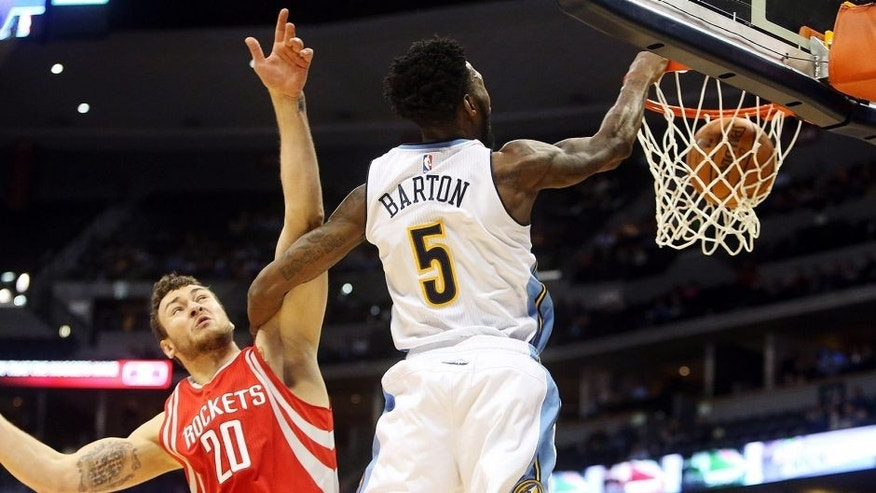 <p>Dec 14, 2015; Denver, CO, USA; Denver Nuggets forward Will Barton (5) dunks the ball against Houston Rockets forward Donatas Motiejunas (20) during the first half at Pepsi Center. Mandatory Credit: Chris Humphreys-USA TODAY Sports</p>
