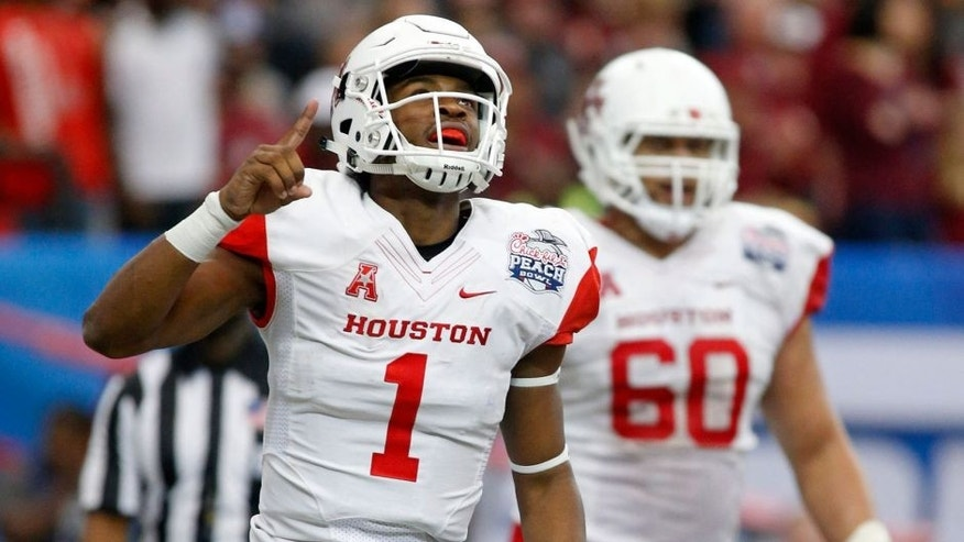 Dec 31, 2015; Atlanta, GA, USA; Houston Cougars quarterback Greg Ward Jr. (1) celebrates after scoring a touchdown in the second quarter against the Florida State Seminoles in the 2015 Chick-fil-A Peach Bowl at the Georgia Dome. Mandatory Credit: Jason Getz-USA TODAY Sports