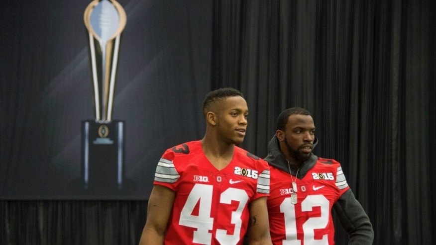 <p>Ohio State Buckeyes linebacker Darron Lee (43) and cornerback Doran Grant (12) talk during Media Day for the College Football Playoff National Championship at Dallas Convention Center.</p>