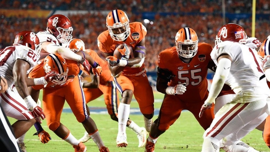 Dec 31, 2015; Miami Gardens, FL, USA; Clemson Tigers running back Wayne Gallman (9) runs in to the end zone to score a touchdown against the Oklahoma Sooners in the third quarter of the 2015 CFP Semifinal at the Orange Bowl at Sun Life Stadium. Mandatory Credit: John David Mercer-USA TODAY Sports