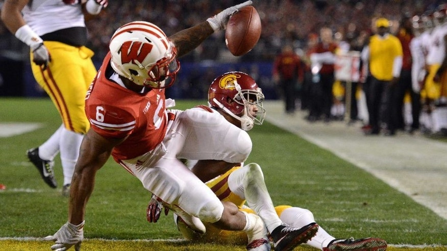 <p>Dec 30, 2015; San Diego, CA, USA; Wisconsin Badgers running back Corey Clement (6) celebrates after scoring a touchdown as USC Trojans cornerback Iman Marshall (8) defends during the second quarter in the 2015 Holiday Bowl at Qualcomm Stadium. Mandatory Credit: Jake Roth-USA TODAY Sports</p>