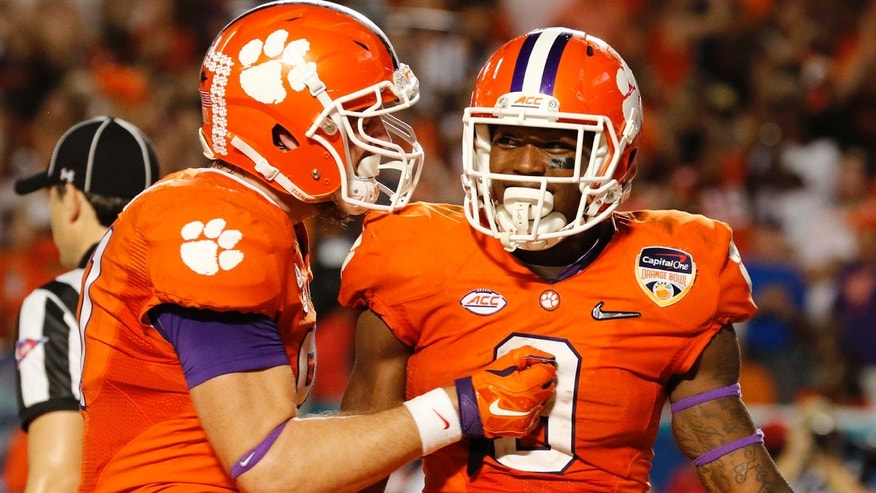 Dec. 31, 2015: Clemson running back Wayne Gallman (9) is congratulated by tight end Stanton Seckinger (81) during the second half of the Orange Bowl NCAA college football semifinal playoff game against Oklahoma in Miami Gardens, Fla. (AP Photo/Joe Skipper)