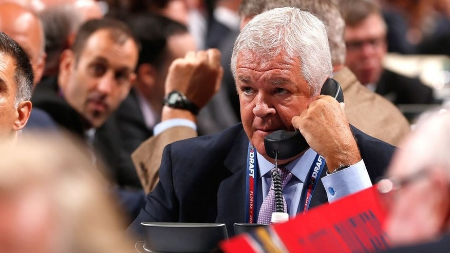 SUNRISE, FL - JUNE 26: General Manager Dale Tallon of the Florida Panthers talks on the phone at the draft table during Round One of the 2015 NHL Draft at BB&T Center on June 26, 2015 in Sunrise, Florida. (Photo by Eliot J. Schechter/NHLI via Getty Images)