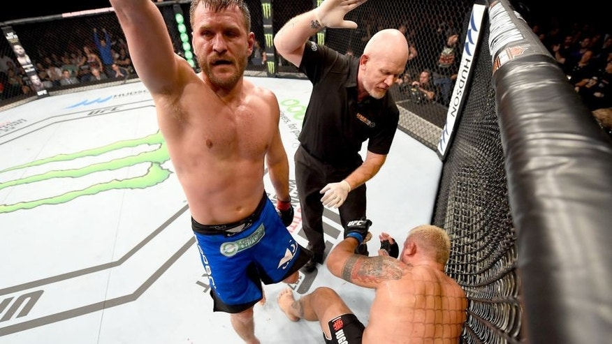ADELAIDE, AUSTRALIA - MAY 10: (L-R) Stipe Miocic celebrates his TKO victory over Mark Hunt in their heavyweight bout during the UFC Fight Night event at the Adelaide Entertainment Centre on May 10, 2015 in Adelaide, Australia. (Photo by Josh Hedges/Zuffa LLC/Zuffa LLC via Getty Images)
