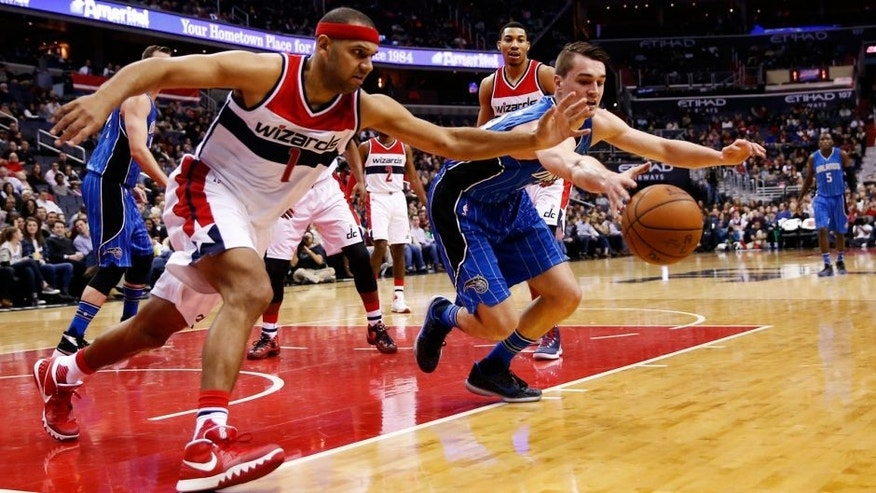 Washington Wizards forward Jared Dudley (1) and Orlando Magic guard Mario Hezonja (23), from Croatia, scramble for the rebound in the first half of an NBA basketball game, Friday, Jan. 1, 2016, in Washington. (AP Photo/Alex Brandon)