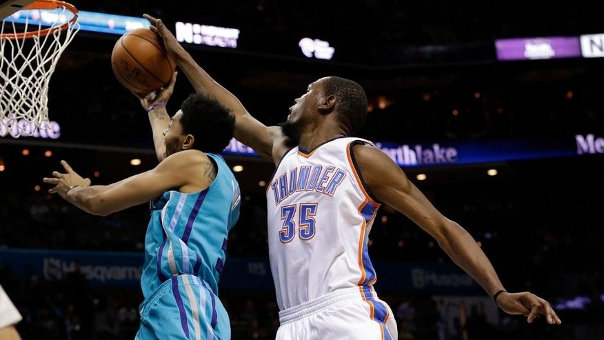 Jan 2, 2016; Charlotte, NC, USA; Oklahoma City Thunder forward Kevin Durant (35) blocks the shot of Charlotte Hornets guard Jeremy Lamb (3) from behind in the second half at Time Warner Cable Arena. The Thunder defeated the Hornets 109-90. Mandatory Credit: Jeremy Brevard-USA TODAY Sports