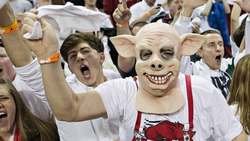 FAYETTEVILLE, AR - JANUARY 14: Fans of the Arkansas Razorbacks celebrate after an overtime win against the Kentucky Wildcats at Bud Walton Arena on January 14, 2014 in Fayetteville, Arkansas. The Razorbacks defeated the Wildcats 87-85. (Photo by Wesley Hitt/Getty Images)
