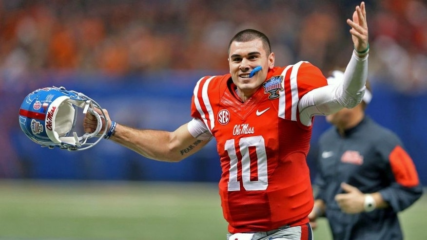 Jan 1, 2016; New Orleans, LA, USA; Mississippi Rebels quarterback Chad Kelly (10) gestures while running off the field at the end of the the second quarter against the Oklahoma State Cowboys in the 2016 Sugar Bowl at the Mercedes-Benz Superdome. Mandatory Credit: Chuck Cook-USA TODAY Sports