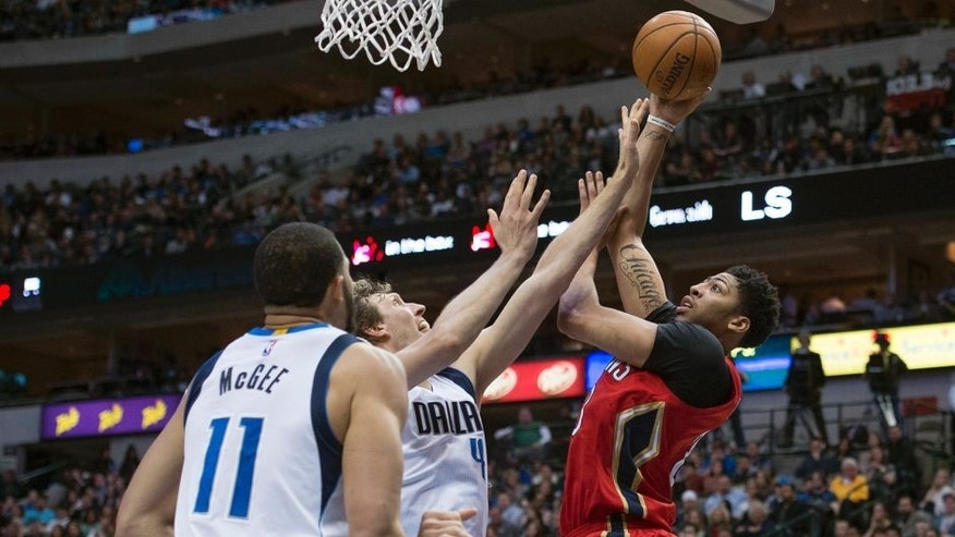 Jan 2, 2016; Dallas, TX, USA; New Orleans Pelicans forward Anthony Davis (23) shoots over Dallas Mavericks forward Dirk Nowitzki (41) and center JaVale McGee (11) during the second half at the American Airlines Center. The Pelicans defeat the Mavericks 105-98. Mandatory Credit: Jerome Miron-USA TODAY Sports