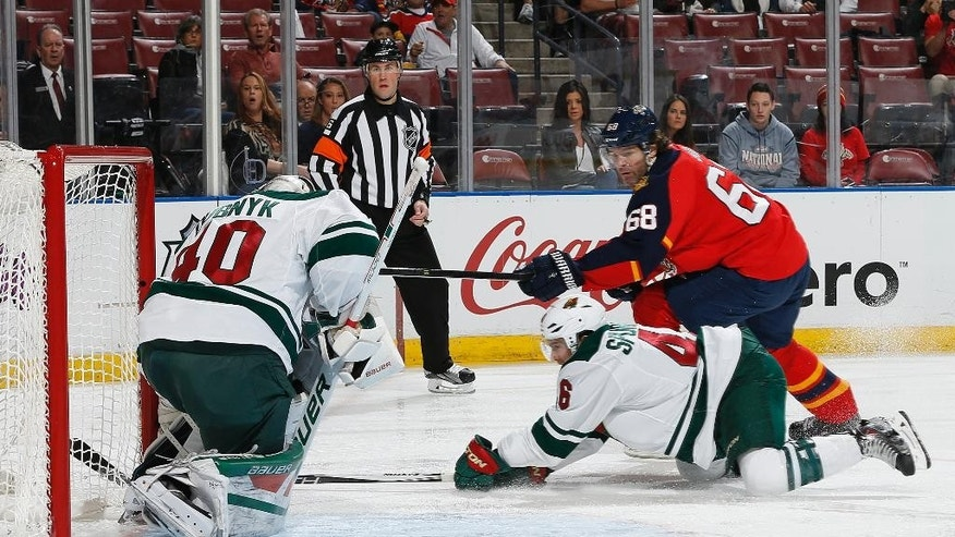 Florida Panthers forward Jaromir Jagr (68) scores a goal past Minnesota Wild's goaltender Devan Dubnyk (40) during the first period of an NHL hockey game, Sunday, Jan. 3, 2016, in Sunrise, Fla. (AP Photo/Joel Auerbach)