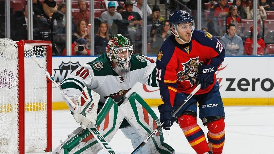 Minnesota Wild's goaltender Devan Dubnyk (40) defends the net against Florida Panthers forward Vincent Trocheck (21) during the first period of an NHL hockey game, Sunday, Jan. 3, 2016, in Sunrise, Fla. (AP Photo/Joel Auerbach)