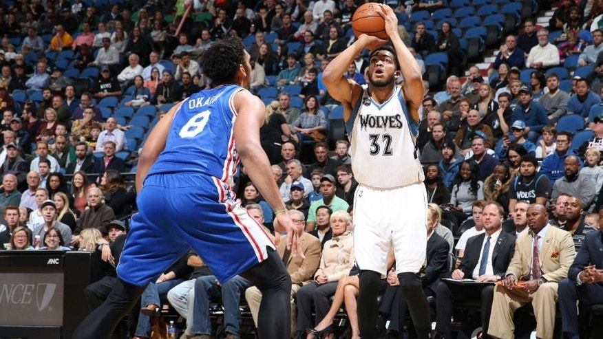 MINNEAPOLIS, MN - NOVEMBER 23: Karl-Anthony Towns #32 of the Minnesota Timberwolves shoots against the Philadelphia 76ers during the game on November 23, 2015 at Target Center in Minneapolis.