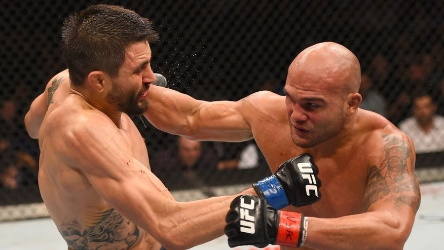 LAS VEGAS, NV - JANUARY 02: (R-L) Robbie Lawler punches Carlos Condit in their UFC welterweight championship bout during the UFC 195 event inside MGM Grand Garden Arena on January 2, 2016 in Las Vegas, Nevada. (Photo by Josh Hedges/Zuffa LLC/Zuffa LLC via Getty Images)