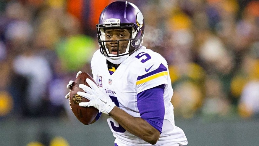 Jan 3, 2016; Green Bay, WI, USA; Minnesota Vikings quarterback Teddy Bridgewater (5) looks to pass during the first quarter against the Green Bay Packers at Lambeau Field. Mandatory Credit: Jeff Hanisch-USA TODAY Sports