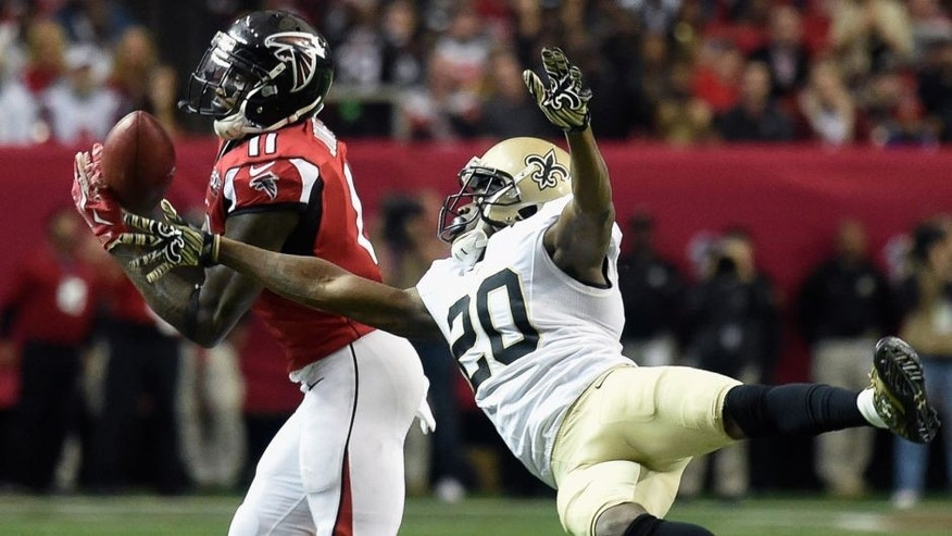Jan 3, 2016; Atlanta, GA, USA; Atlanta Falcons wide receiver Julio Jones (11) catches a pass defended by New Orleans Saints defensive back Brian Dixon (20) during the fourth quarter at the Georgia Dome. The Saints defeated the Falcons 20-17. Mandatory Credit: Dale Zanine-USA TODAY Sports