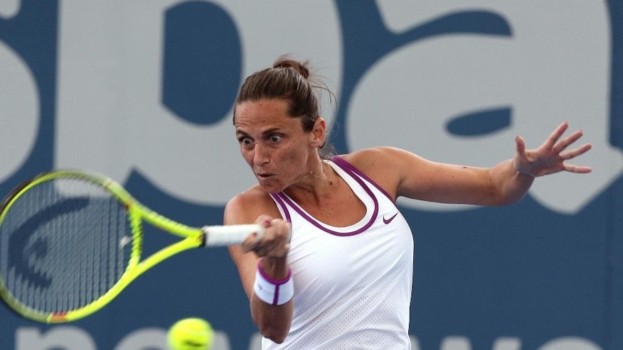 Roberta Vinci of Italy plays a shot in her match against Dominika Cibulkova of Slovakia during the Brisbane International tennis tournament in Brisbane, Australia, Tuesday, Jan. 5, 2016. (AP Photo/Tertius Pickard)