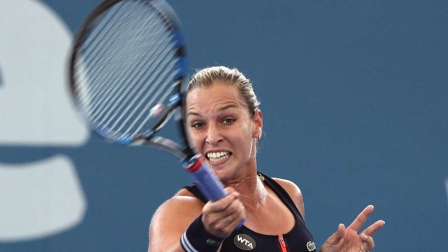 Dominika Cibulkova of Slovakia plays a shot in her match against Roberta Vinci of Italy during the Brisbane International tennis tournament in Brisbane, Australia, Tuesday, Jan. 5, 2016. (AP Photo/Tertius Pickard)