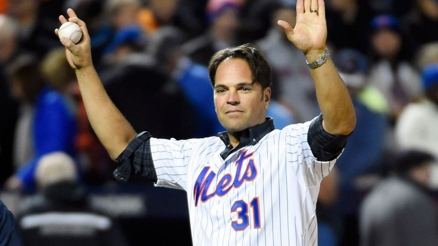 Oct 30, 2015; New York City, NY, USA; New York Mets former catcher Mike Piazza waves to the crowd before throwing the ceremonial first pitch before game three of the World Series against the Kansas City Royals at Citi Field. Mandatory Credit: Robert Deutsch-USA TODAY Sports
