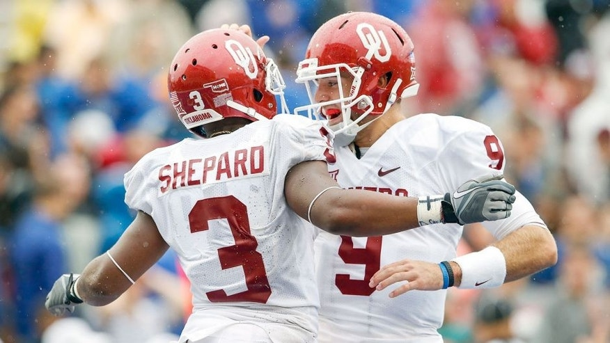 Sep 6, 2014; Tulsa, OK, USA; Oklahoma Sooners wide receiver Sterling Shepard (3) celebrates scoring a touchdown with quarterback Trevor Knight (9) during the second half against the Tulsa Golden Hurricane at Skelly Field at H.A. Chapman Stadium. Mandatory Credit: Kevin Jairaj-USA TODAY Sports