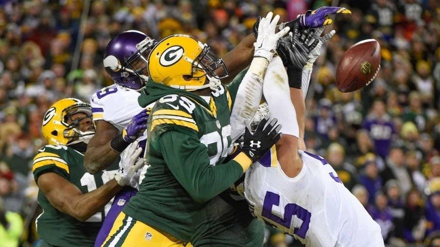 Green Bay Packers wide receiver James Jones cannot catch a Hail Mary pass in the last second of the game against Minnesota Vikings linebacker Anthony Barr at Lambeau Field in Green Bay, Wis., on Sunday, Jan. 3, 2016. The Vikings won 20-13.