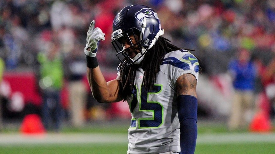Jan 3, 2016; Glendale, AZ, USA; Seattle Seahawks cornerback Richard Sherman (25) reacts during the second half against the Arizona Cardinals at University of Phoenix Stadium. Mandatory Credit: Matt Kartozian-USA TODAY Sports
