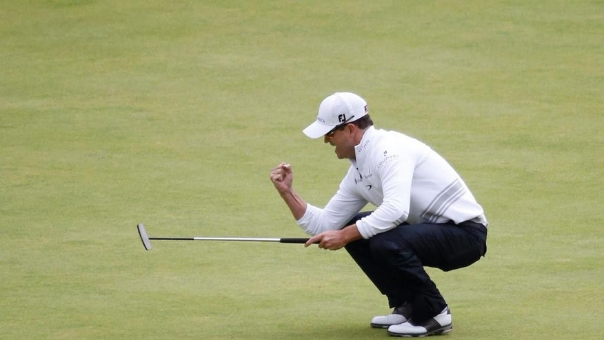 FILE - In this July 20, 2015, file photo, United States' Zach Johnson gets a birdie on the 18th hole during the final round at the British Open Golf Championship at the Old Course in St. Andrews, Scotland. Johnson is among eight players who have signed to play PXG golf clubs this year. PXG is owned by GoDaddy founder Bob Parsons, who thinks there is a market for clubs that cost $5,000 for a full set. (AP Photo/Alastair Grant, File)