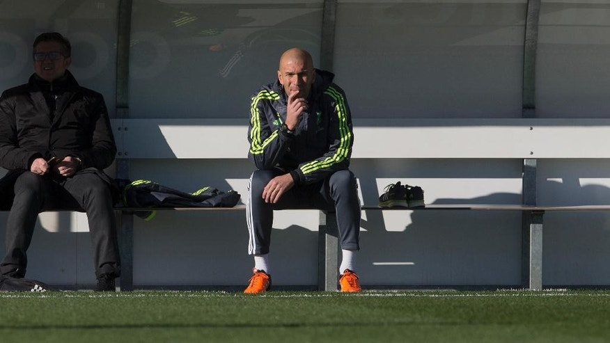 Real Madrid's newly appointed coach Zinedine Zidane sits on the bench during his first training session in Madrid, Spain, Tuesday Jan. 5, 2016. Real Madrid fired coach Rafael Benitez Monday after seven months and replaced him with former player Zinedine Zidane a day after Madrid's 2-2 draw at Valencia deepened a crisis that started with an embarrassing 4-0 home loss to rival Barcelona in November. (AP Photo/Paul White)